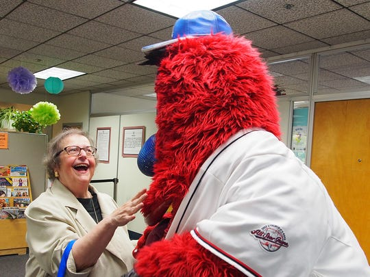 Archie, the Reno Aces mascot, shares a joke with Anne at 2014's Older American Month's celebration