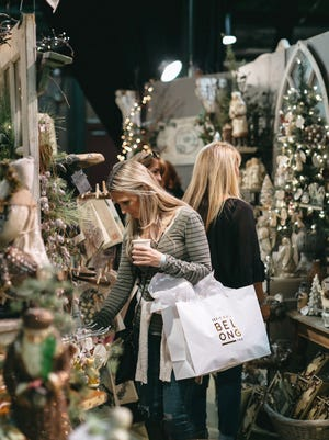 Shoppers peruse the eclectic wares of The City Farmhouse Holiday Pop-Up Fair.