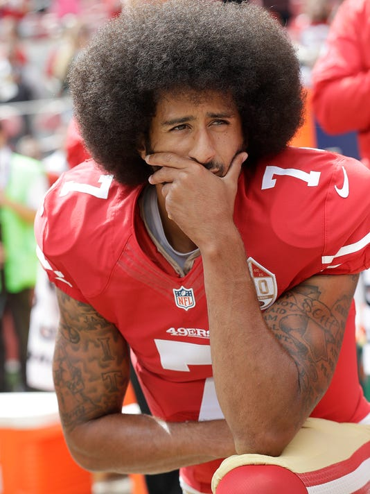 FILE - In this Oct. 2, 2016, file photo, San Francisco 49ers quarterback Colin Kaepernick kneels during the national anthem before an NFL football game against the Dallas Cowboys, in Santa Clara, Calif. Spooked by another big dip in the television ratings and an increasing number of empty seats, the league seems determined to banish peaceful protest from the playing field. (AP Photo/Marcio Jose Sanchez, File)