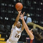 Southern Miss guard Brittny Norris takes a shot Saturday during the Lady Eagles' game against Samford. Southern Miss won, 56-48, to win the Lady Eagle Thanksgiving Tournament.