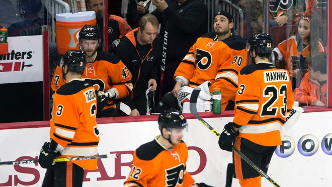 """Flyers' goalie Michal Neuvirth missed the game because he """"wasn't feeling right"""" according to GM Ron Hextall."""