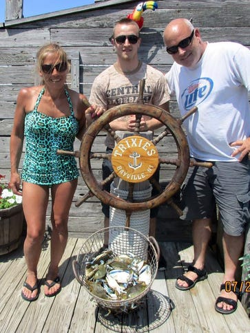 The Simpson family of Jackson with their catch of blue