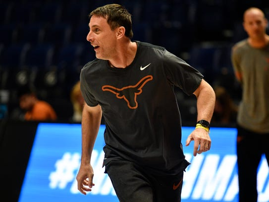 Texas assistant coach Darrin Horn run with his team