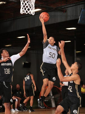 Kentucky point guard recruit Tremont Waters attacks the basket during an adidas Nations workout in July of 2015.