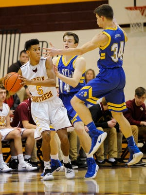 Castle's Noah Mclean (34) and Castle's Brandon Eades (14) guard Gibson Southern's Alec Martin (5) during the Toyota Classic at Gibson Southern High School in Fort Branch, Monday, Dec. 19, 2016. Castle beat Gibson Southern 75-42.