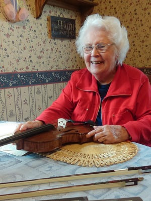 Grace Huenink of Okauchee was reunited with her violin for her 90th birthday.