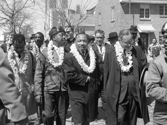 Rev. Martin Luther King Jr., center, is seen during the Selma-to-Montgomery march with other civil rights activists on March 21, 1965.