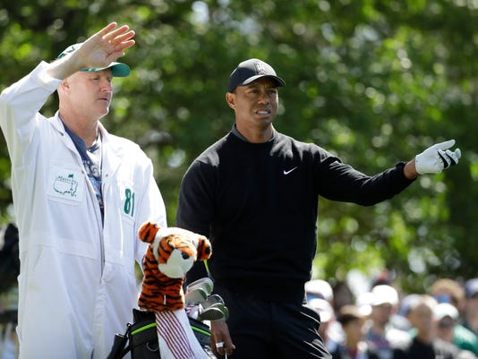 Tiger Woods looks over a shot on the fourth hole during the first round at the Masters golf tournament Thursday, April 5, 2018, in Augusta, Ga. (AP Photo/Matt Slocum)