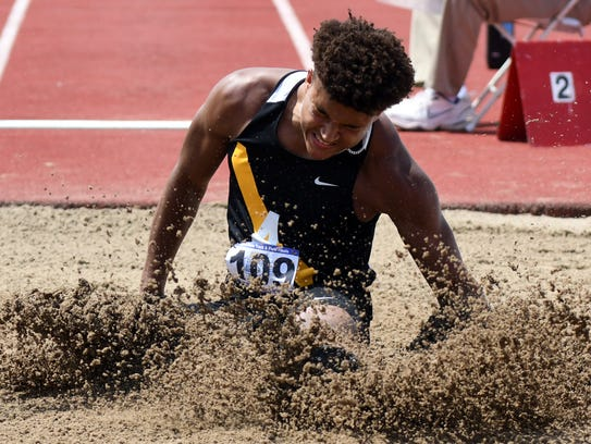 Avon's Isaac Guerendo competes in the long jump during