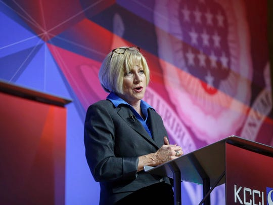 Cathy Glasson, one of five democratic candidates for Iowa governor, answers a question during the 2018 Iowa democratic gubernatorial primary debate in Des Moines on Wednesday, May 30, 2018.