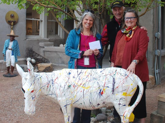 Carrizozo teacher Deena O'Dell receives a check for $200 for the school's art program from Gallery 408's Warren and Joan Malkerson.