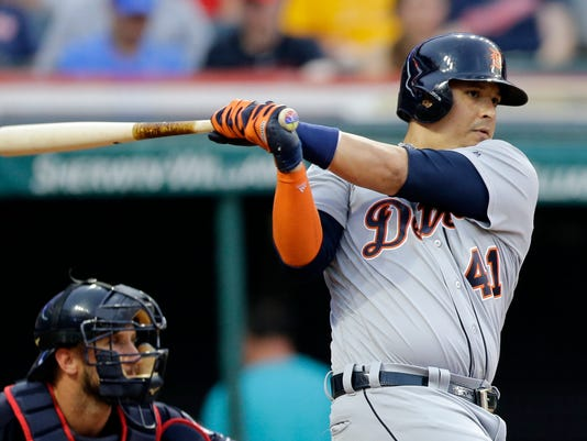 Detroit Tigers' Victor Martinez grounds out against Cleveland Indians starting pitcher Carlos Carrasco during the fourth inning of a baseball game, Friday, July 7, 2017, in Cleveland. (AP Photo/Tony Dejak)