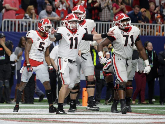 Georgia Bulldogs quarterback Jake Fromm (11) celebrates