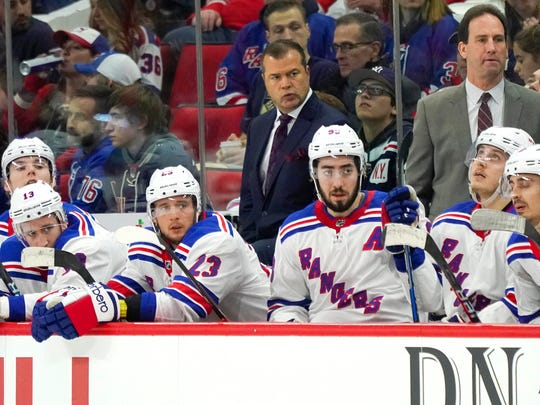Mar 31, 2018; Raleigh, NC, USA;  New York Rangers head coach Alain Vigneault looks on from behind the players bench against the Carolina Hurricanes at PNC Arena. The New York Rangers defeated the Carolina Hurricanes 2-1.