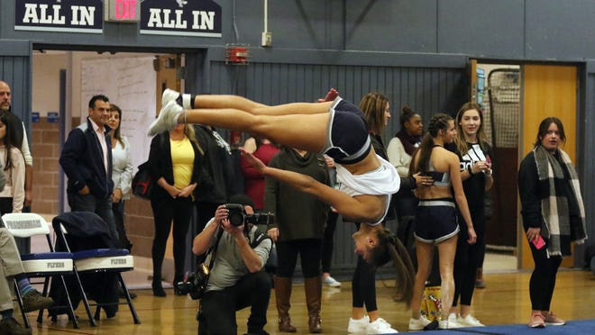"Framingham High cheerleader Sophie Albright, shown warming up before the start of the Framingham Flyer Cheerleaders' ""Friends and Family Showcase"" on Nov. 22, 2019, hasn't been able to cheer with her teammates thanks to the ongoing COVID-19 pandemic."