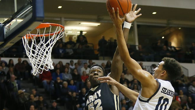 Army Black Knights guard John Emezie (52) defends against Monmouth Hawks guard Micah Seaborn (10) during first half at OceanFirst Bank Center, West Long Branch,NJ. Saturday, December 10, 2016. Noah K. Murray-Correspondent/Asbury Park Press ASB 1211 Monmouth Basketball