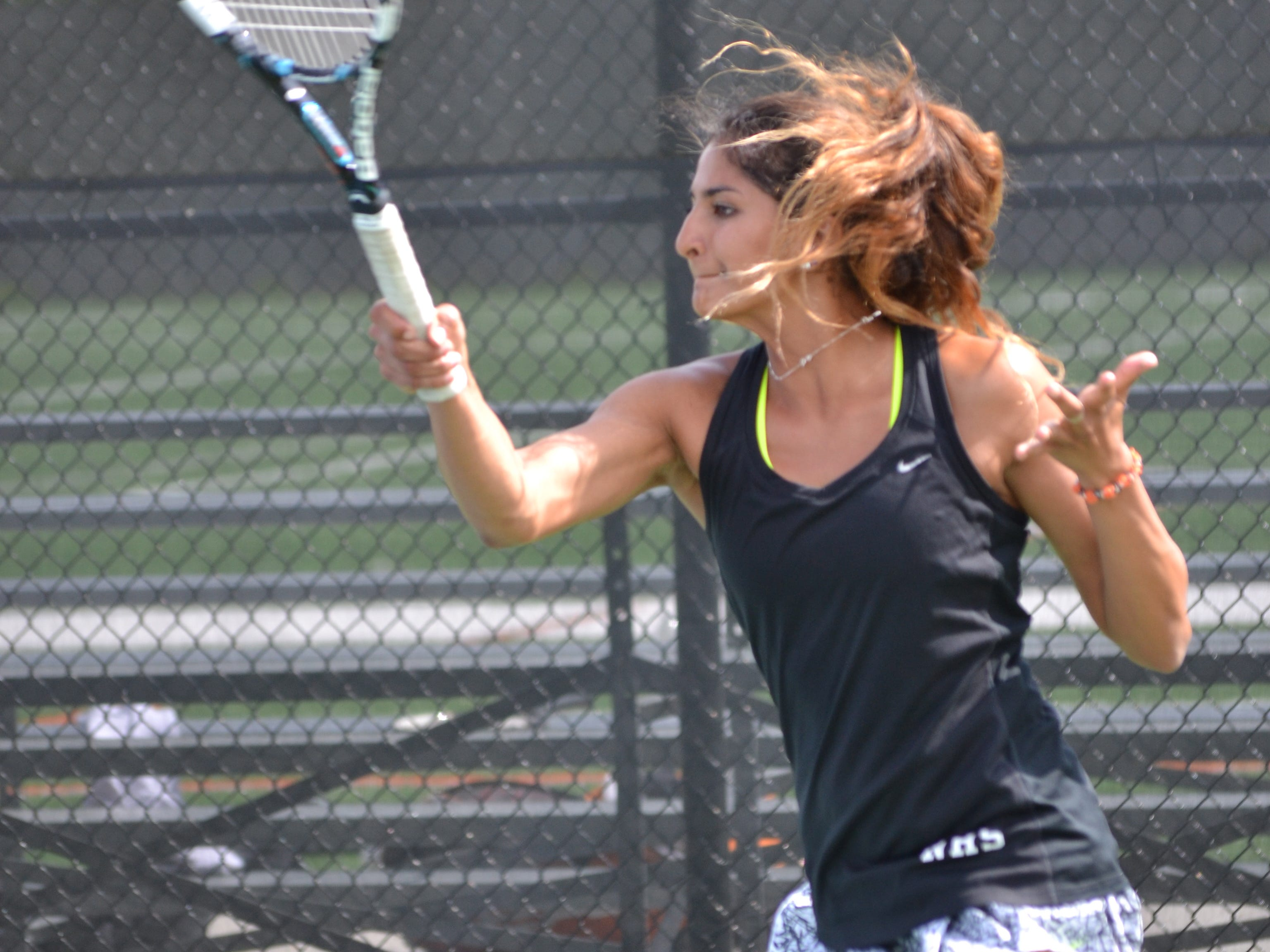 Northville No. 1 doubles player Anika Mukherji hits a forehand during the KLAA Association 'A' tournament at Brighton.