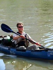 Army veteran Bart Lindberg paddles down the Mississippi