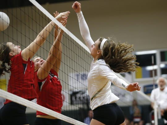 Lincoln sophomore Kaylyn Buchanan gets a kill attempt