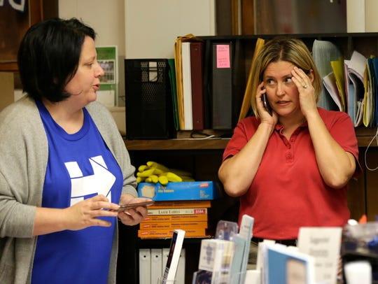 Sen. Julie Lassa reacts to poll numbers during the
