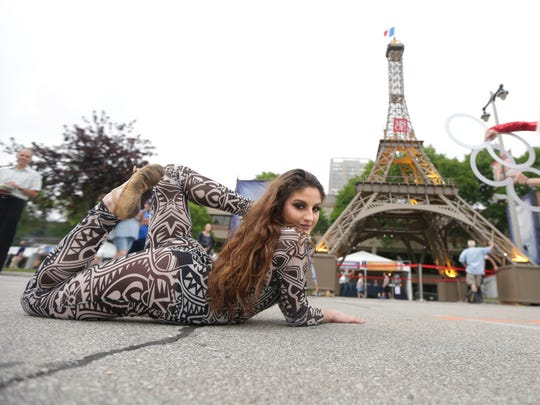 Nikki Palumbo, a contortionist with the Carnival of Curiosity and Chaos of Chicago, shows her flexibility while performing at Milwaukee's Bastille Days in 2018.