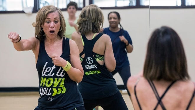 Stephanie Lackey leads a class in Zumba Fitness at the Baptist Health/Milestone Wellness Center on Monday night. 4/25/16