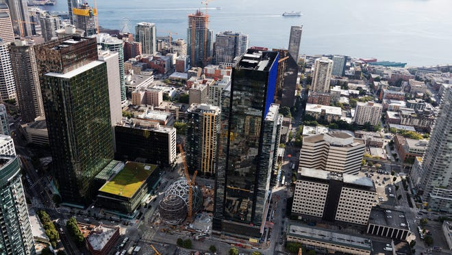 Amazon's headquarters in Downtown Seattle is anchored by two skyscrapers with a third in the works.