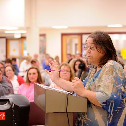 Kate Lambert address the North Fork School Board during