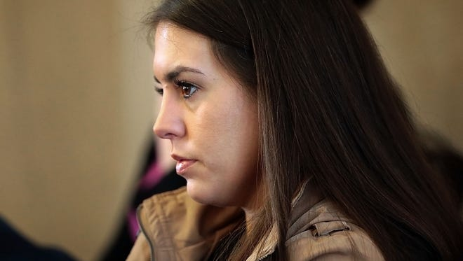 Noura Jackson listens as Assistant District Attorney Steve Jones testifies in a Tennessee Supreme Court ethics hearing regarding his failure to disclose information to the defense during Jackson's trial.
