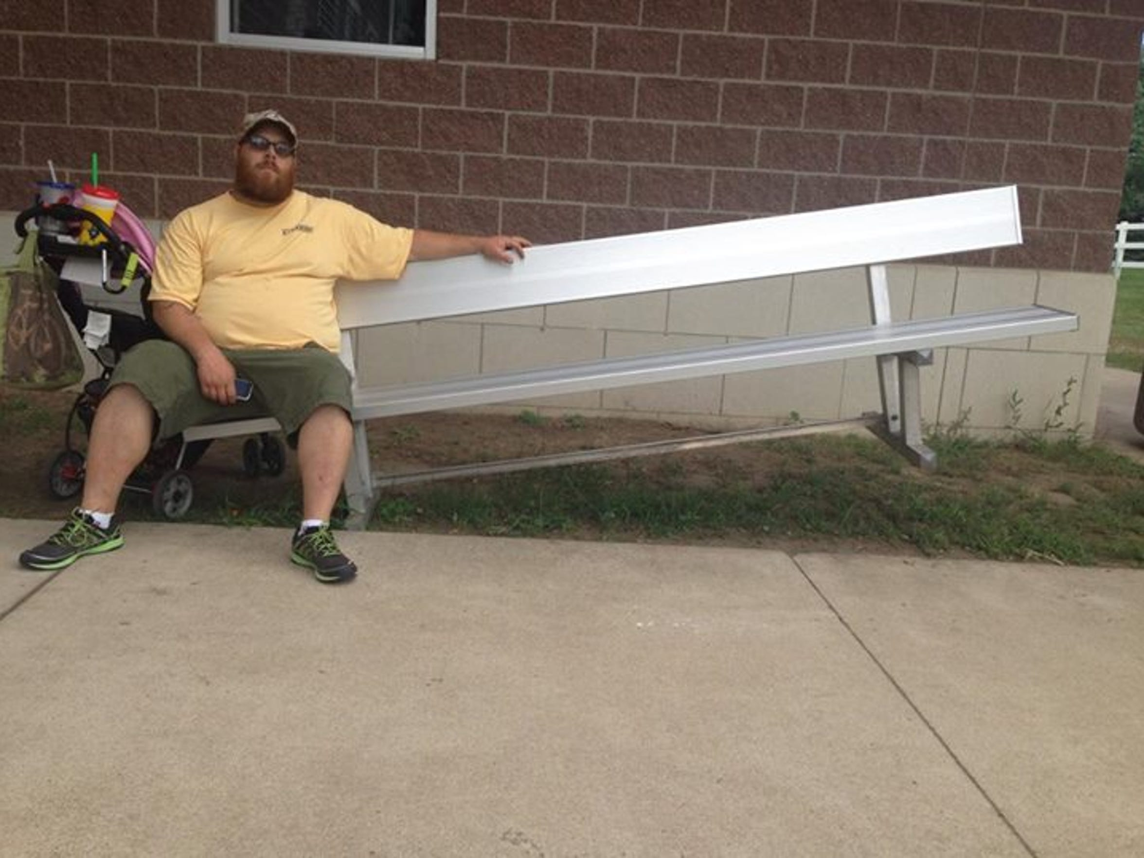 """The comments on the """"The People of the Iowa State Fair"""" page indicated that the man sitting on the bench himself suggested the photo."""