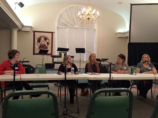 Panelists speak at a summit on foster care at First Baptist Church in Waynesboro about foster care.