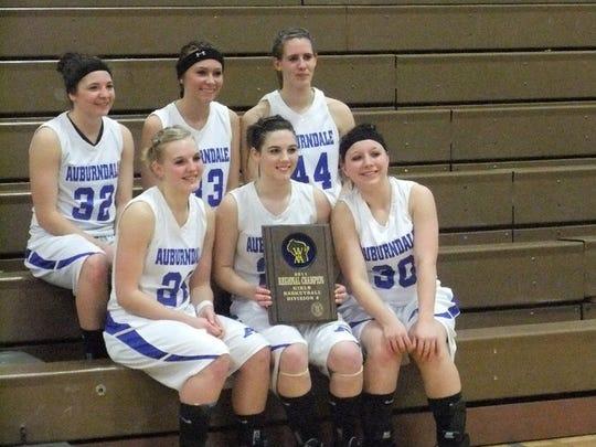 The Auburndale High School girl's basketball team poses for a photo after winning the 2011 regional championship. Top row: Kelly Tomfohrde, Lindsay Gorman and Liz Breu. Bottom row: Kayla Nikolay, Kayleigh Kundinger and Katie Willfahrt.