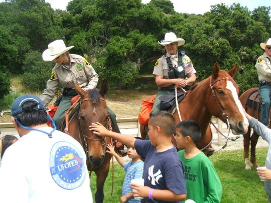 Members of the first Monterey County Sheriff's Office Mounted Unit often do community outreach events to give people experience with horses.