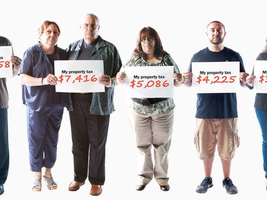 Shore residents show the amounts that appeared on their property tax bills.
