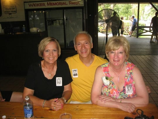 Gonzalo Curiel returned to Indiana in 2011 for a 40th reunion with his high school class from Bishop Noll Institute in Hammond. He is seen here with classmates Shirley Wade (left) and Judi McCarthy.