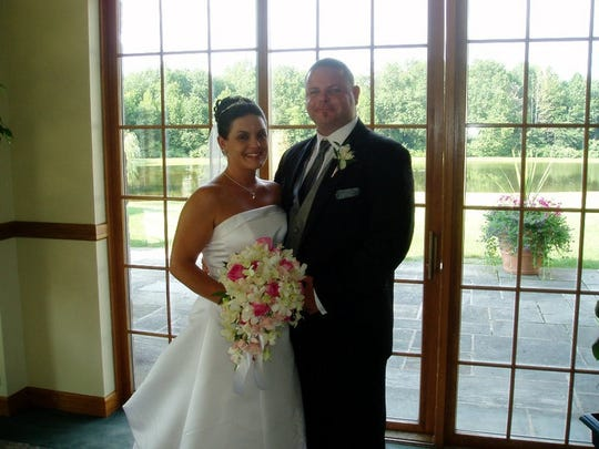 Melissa Reilley-Grecoo and her husband.