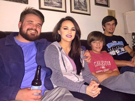 Siblings Austin Merrell, Chelsey Merell Hobbs, Andy Merrell, and Skyler Merrell, pause for a photo before the 2016 Super Bowl in Corryton. This is the last photo of all four together before the February 24th car accident which ended Austin and Andy's lives.