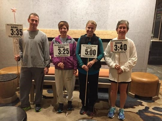 Local finishers at last week's Harrisburg Marathon were, from left to right, John Nogle, Kristal Hollenshead, Brooke Schellhase and Denise Smith.