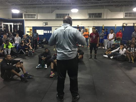 Corey Fuller addresses Godby's football players for