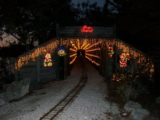 Hop aboard the Holiday Express train, running  through the miniature train village and a holiday inflatable area through Dec. 30.