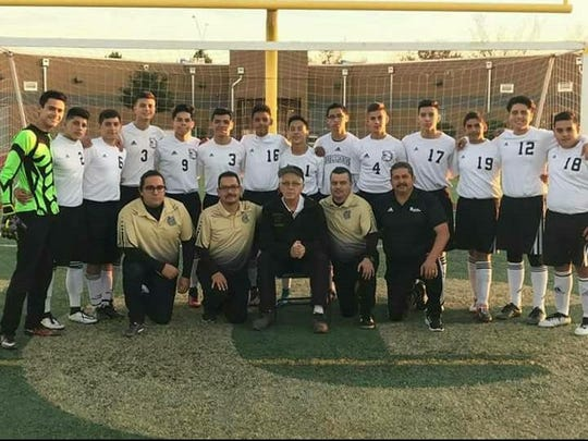Douglas boys soccer coach Ken Cormier (front row, center,