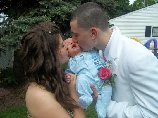Jack and Alina kiss their son before going to the prom