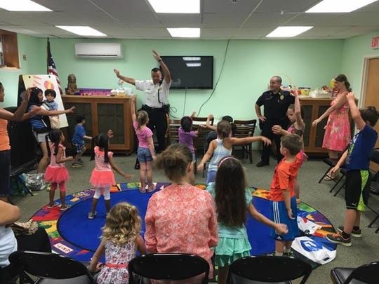"""East Rutherford Memorial Library director Christine Hartigan called police chief Larry Minda """"a big kid"""" and said the parents and children love when he reads to them."""
