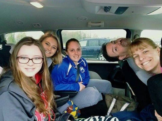Keller and her coaches pose for a photo during their trip to Indianapolis.