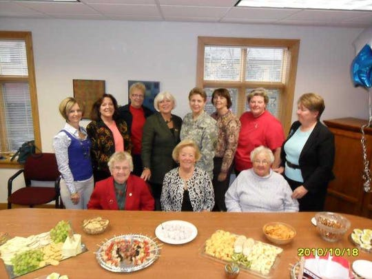 Ruth Dietz (seated from left) with Redith Snoberger and Betty Eiceman at a luncheon of past Athena Award winners held in 2010 that also included (standing from left) Vickie DeLoatch, Kim Krieder Umble, Diana Hartman, Adj. Gen. Jessica Wright, RoseMarie Swanger, Kathy Snavely and Jo Ellen Litz