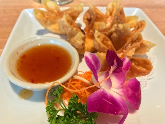 Crab rangoon at Komoon Thai Sushi & Ceviche is served