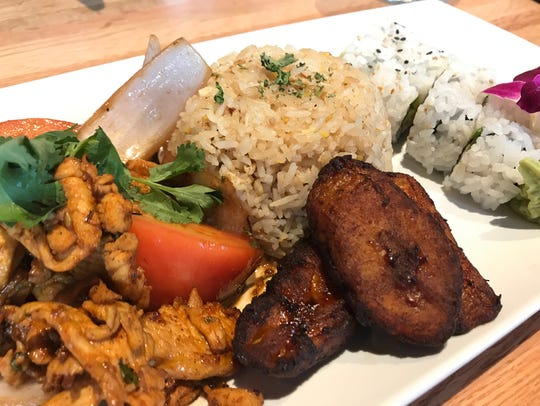 A pick two combo of a California roll, fried plantains,