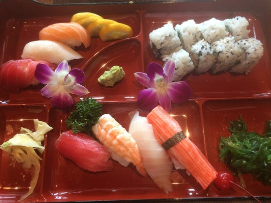 The sushi combo on the list of Komoon lunch specials comes with seven pieces of sushi chosen by the chef and a choice of a California, tuna, salmon or spicy tuna roll.