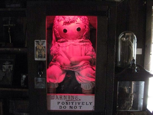 The true Annabelle doll is the centerpiece of Ed and