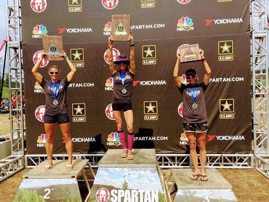 Cheryl Scholl, right, poses for a photo after finishing as the third Masters runner in the Elite Division at the West Virginia Spartan Super race, which was held in Glen Jean, W.Va. on Aug. 26-27.